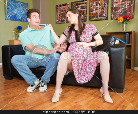 Mad Pregnant Lady Grabs Man stock photo, Angry expecting mother grabbing the collar of husband by Scott Griessel