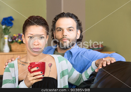 Serious Couple Holding Hands stock photo, Serious handsome man with beautiful woman holding hands by Scott Griessel