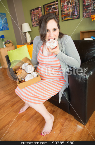 Barefoot Pregnant Lady Eating stock photo, Happy barefoot pregnant woman eating from box of donuts by Scott Griessel