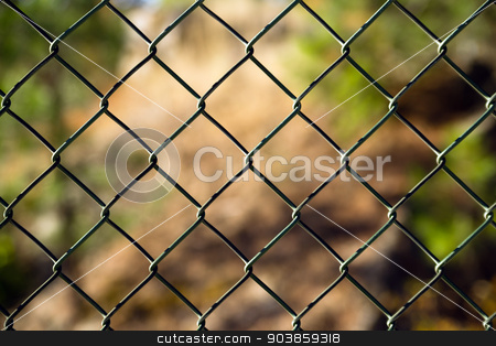 Diagonal Diamond Pattern Chain Link Fence Outside Boundary stock photo, An ordinary chain link fence section by Christopher Boswell