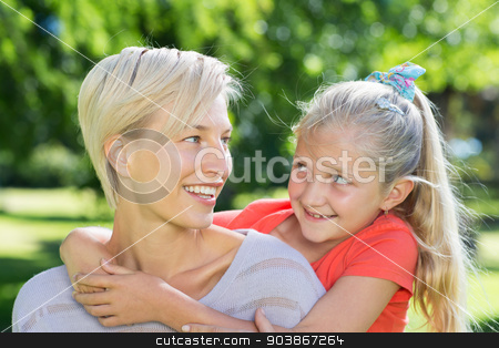 Happy blonde with her daughter in the park  stock photo, Happy blonde with her daughter in the park on a sunny day by Wavebreak Media