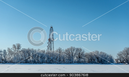 winter landscape stock photo, Winter landscape. Drilling rig for the snow-covered forest by zybr78