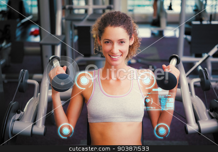 Composite image of fit smiling woman using the weights machine f stock photo, Fit smiling woman using the weights machine for her arms  against fitness interface by Wavebreak Media