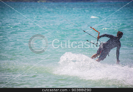 Male Kit Surfer stock photo, Male kite surfer moving over ocean surface by Scott Griessel