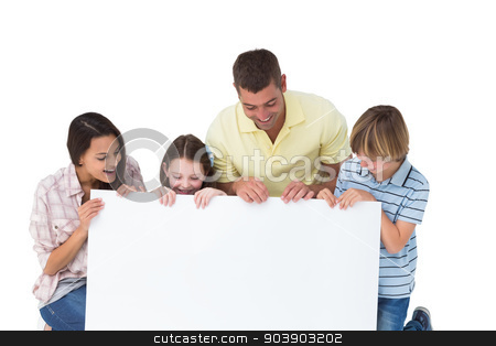Family of four looking at billboard stock photo, Happy family of four looking at billboard over white background by Wavebreak Media