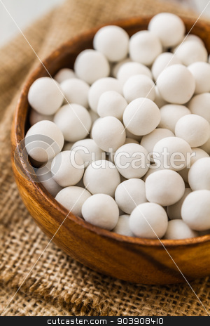 White Roasted Chickpeas stock photo, White roasted chickpeas in brown wooden bowl on linen napkin by OZMedia