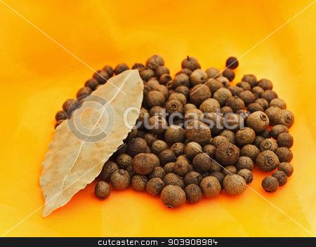 Allspice stock photo, Allspice And Bay Leaf Over Orange Textile Background by Sergej Razvodovskij
