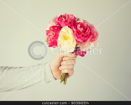 man's hand giving bouquet of flowers stock photo, close up of man's hand giving bouquet of flowers. by Syda Productions