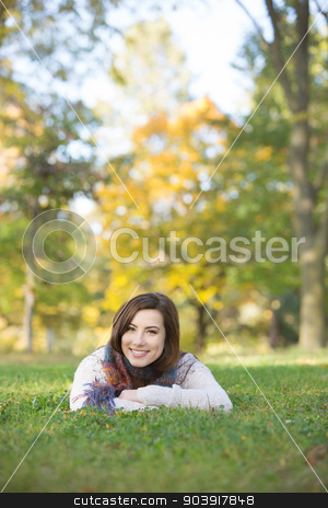 Smiling Teen Outdoors stock photo, Happy Caucasian teen girl laying down outdoors by Scott Griessel
