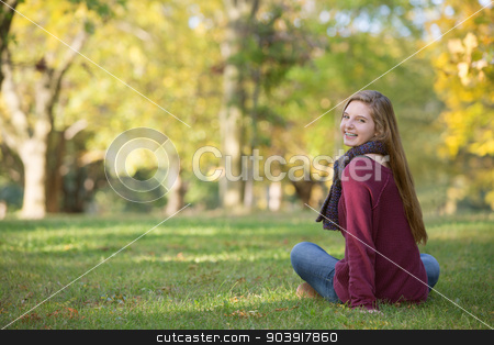 Back of Girl Smiling stock photo, Back of cute girl looking over shoulder outdoors by Scott Griessel