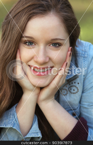 Girl with Hands on Cheeks stock photo, Close up of cute young woman with hands on cheeks by Scott Griessel