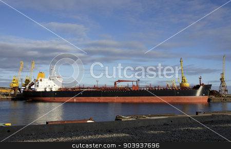 Tanker and  port stock photo, The big tanker costs in port by kolyvanov