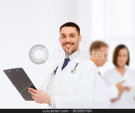 smiling male doctor with clipboard and stethoscope stock photo, medicine, profession, and healthcare concept - smiling male doctor with clipboard and stethoscope writing prescription over white background by Syda Productions