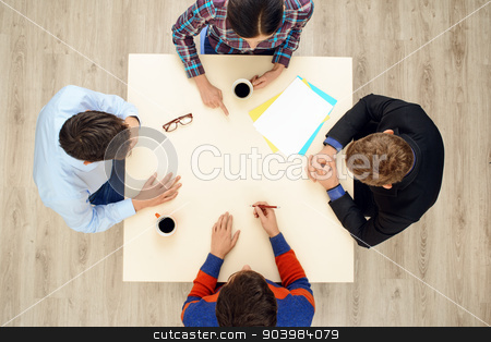 Top view table with group of creative people stock photo, Top view of table with group of busy people working on project. Business team concept by Dmytro Sidelnikov