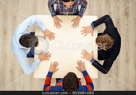 Top view of people with hands on table stock photo, Top view of table with group of creative people working on project. People sitting with their hands on table by Dmytro Sidelnikov