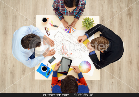 Top view table with group of creative people stock photo, Top view of table with creative people working on business project. Start up concept by Dmytro Sidelnikov