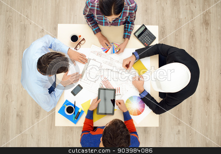 Top view table with creative team  stock photo, Top view of table with group of creative people working on business project. Team discussing construction issues by Dmytro Sidelnikov