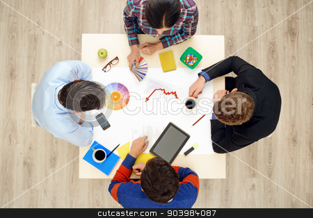Top view table with creative people and gadgets stock photo, Top view of table with gadgets and creative stuff on it. Group of busy creative people working on project. Start up concept by Dmytro Sidelnikov