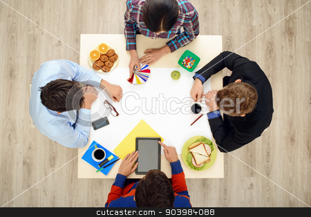 Top view table with creative people stock photo, Top view of table with group of busy creative people working on project. Business team concept by Dmytro Sidelnikov