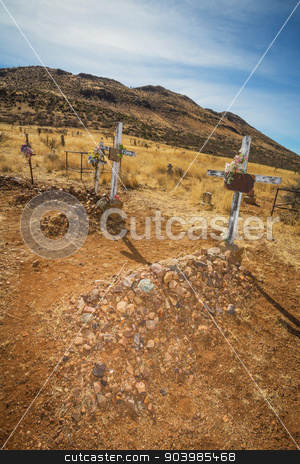 Desert Cemetery Graves stock photo, Three old stone graves in Arizona desert by Scott Griessel