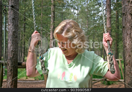 Active Senior Female stock photo, Active Senior Female holding ropes on a course by Lucy Clark