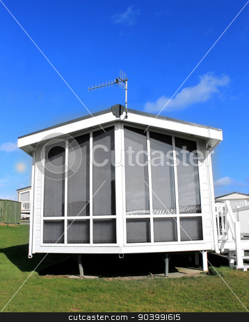 Modern white caravan exterior stock photo, Exterior of a modern white caravan on a park in summer. by Martin Crowdy