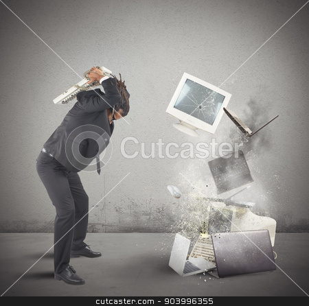 Computer stress stock photo, Businessman stressed out from work breaks computers by Federico Caputo