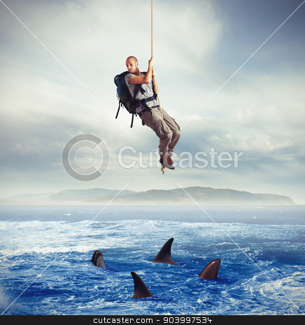 Explorer frightened by sharks stock photo, Explorer frightened by hungry sharks under him by Federico Caputo