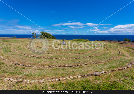 Person Sitting in Maui Labyrinth stock photo, Person meditating in stone labyrinth near Dragon's Teeth by Scott Griessel