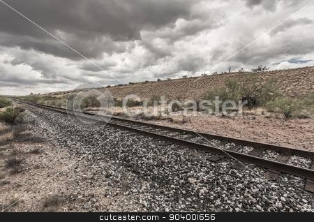 Line of Railroad Tracks in Desert stock photo, Single line of railroad tracks in Arizona desert by Scott Griessel