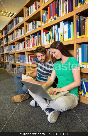 Students sitting on floor in library stock photo, Students sitting on floor in library at the university by Wavebreak Media