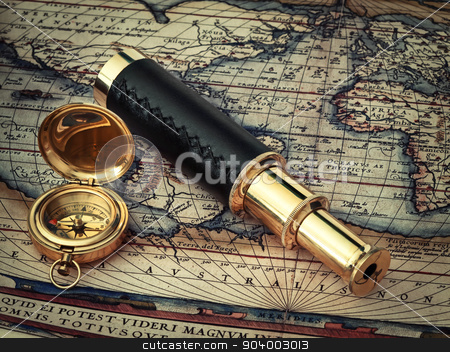 travel stock photo, traveling theme: vintage telescope and compass at antique (17 century) map  by Sergej Razvodovskij