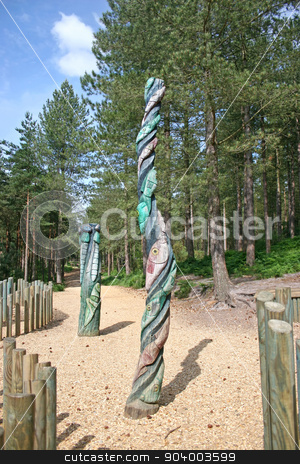 Totem Poles stock photo, Two totem poles in the forest by Lucy Clark