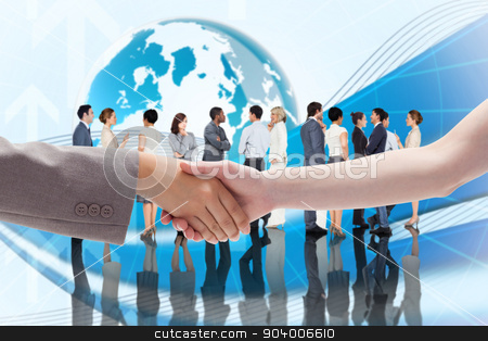 Composite image of handshake between two women stock photo, Handshake between two women against global business graphic in blue by Wavebreak Media
