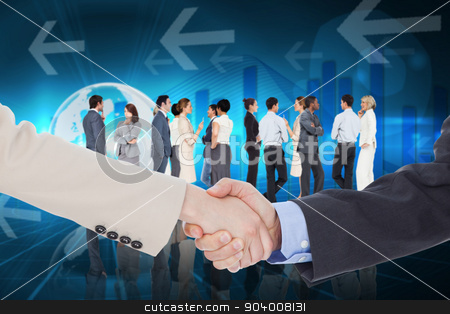 Composite image of smiling business people shaking hands while l stock photo, Smiling business people shaking hands while looking at the camera against global business graphic in blue by Wavebreak Media