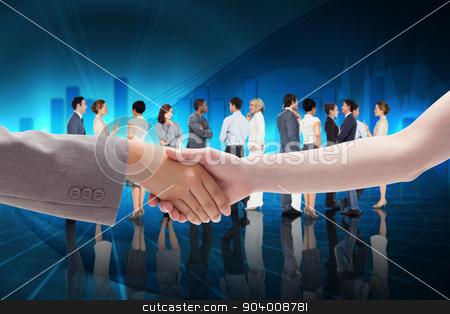 Composite image of handshake between two women stock photo, Handshake between two women against blue bar chart graphic with light by Wavebreak Media