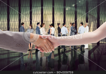 Composite image of handshake between two women stock photo, Handshake between two women against room with large window looking on city by Wavebreak Media