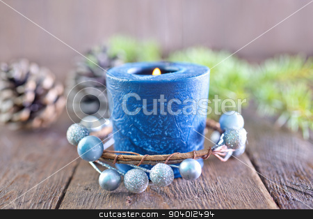 candle stock photo, candle and christmas decoration on a table by tycoon