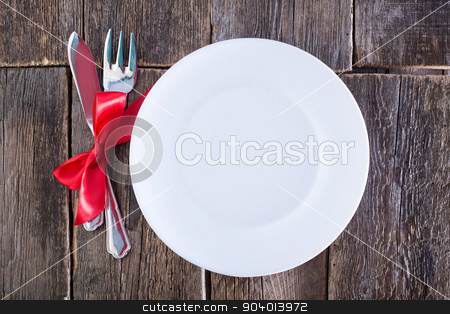 fork and knife on a table stock photo, fork and knife on plate and on a table by tycoon