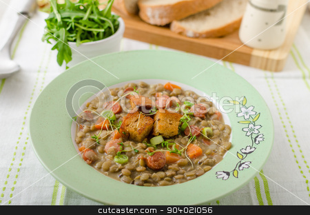 Lentil soup with Viennese sausage stock photo, Lentil soup with Viennese sausage and croutons by Peteer