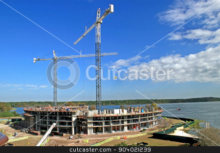 Building Construction stock photo, The construction of a building with 2 cranes by Lucy Clark