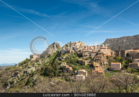 Village of Spelonato in Balagne region of Corsica stock photo, The mountain village of Speloncato in the Balagne region of north Corsica against a blue sky and wispy clouds by Jon Ingall