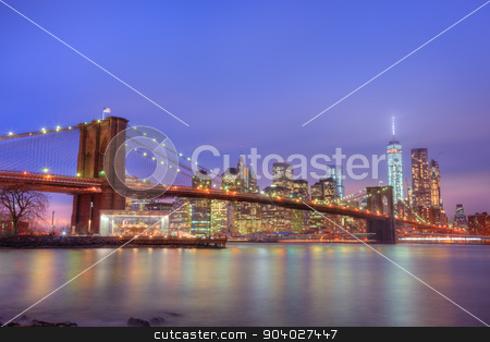 Brooklyn bridge at dusk, New York City. stock photo, Brooklyn bridge and New York City Manhattan downtown skyline at dusk with skyscrapers illuminated over East River panorama. Copy space. by kasto