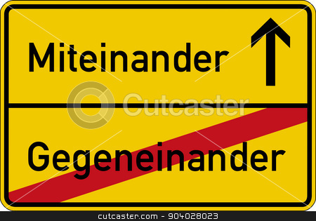 With each other and against each other stock photo, The German words for with each other and against each other (miteinander and gegeneinander) on a road sign by Harry Huber