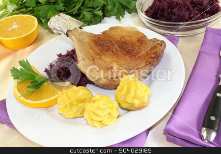 duck drumstick with duchess potatoes stock photo, duck drumstick with duchess potatoes and  red cabbage by Maren Wischnewski