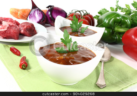 Goulash soup stock photo, fresh Goulash soup with parsley, beef and vegetables by Maren Wischnewski