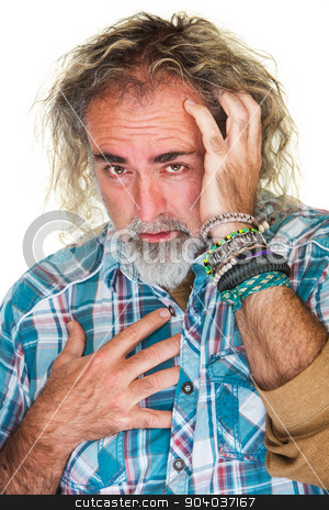 Man with Long Hair stock photo, Anxious bearded male holding chest and head by Scott Griessel