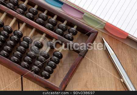Accounting abacus stock photo, Accounting abacus on wooden table with paper and pen by phasinphoto