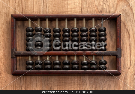 Old abacus stock photo, Old abacus on wooden table by phasinphoto