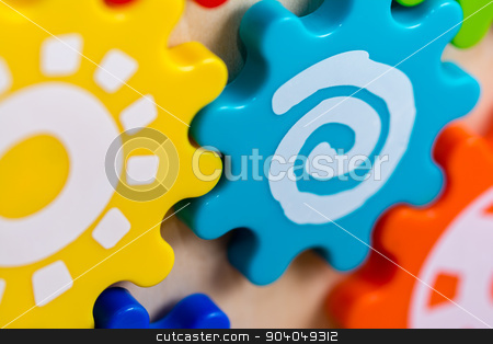 Colorful Toy Gears stock photo, Colorful gears on a children's toy with different white patterns. by Scott Dumas